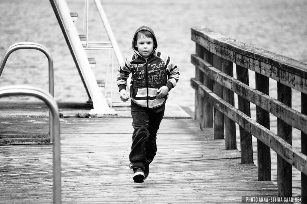 A boy on the dock of Lake Pikku-Ulvaja, Valkeakoski, Finland. Summer 2014, photo Anna-Stiina Saarinen