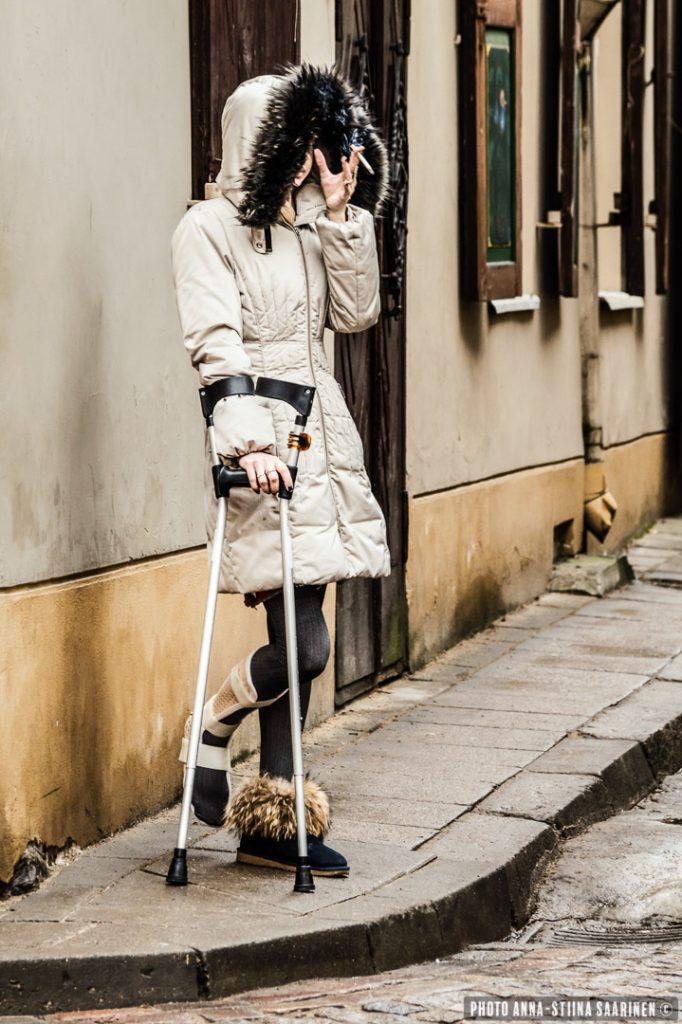 A woman on the corner. Old Town Vilnius, photo Anna-Stiina Saarinen