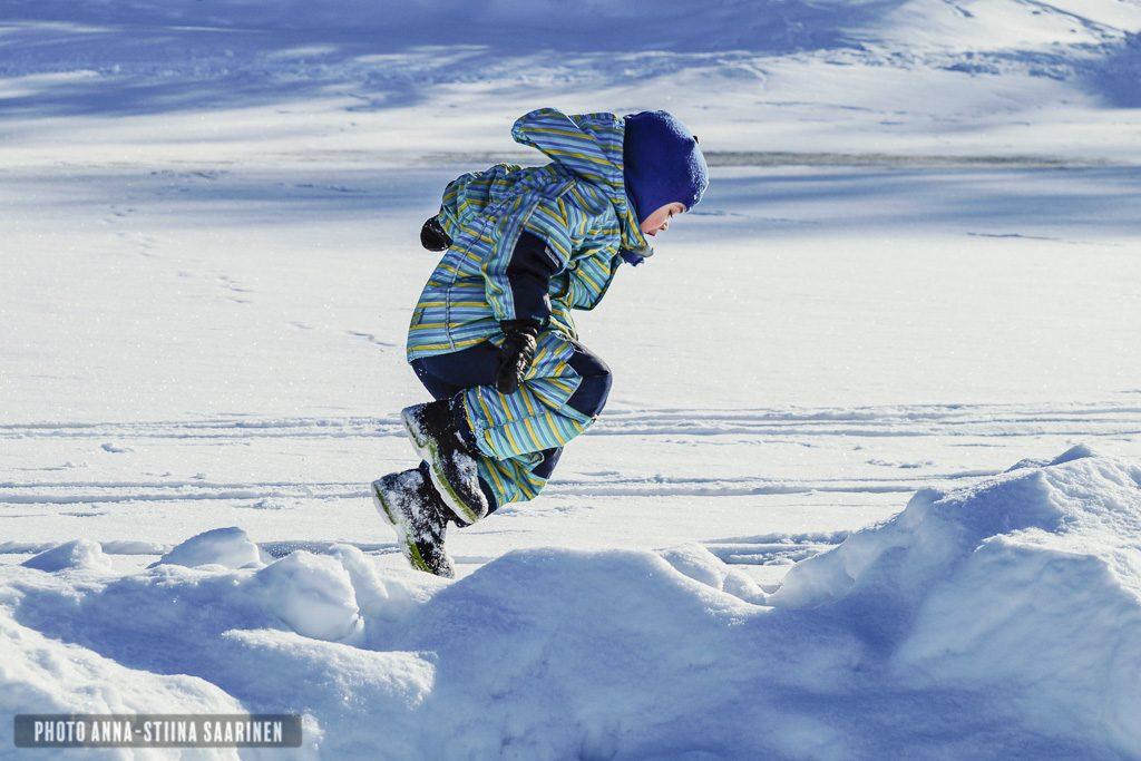 Boy running on lake in winter, Tampere Finland, photo Anna-Stiina Saarinen