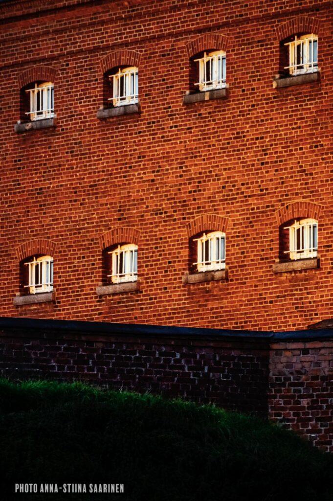The wall of the Hämeenlinna jail in the evening light photo Anna-Stiina Saarinen annastiinasphotos.com