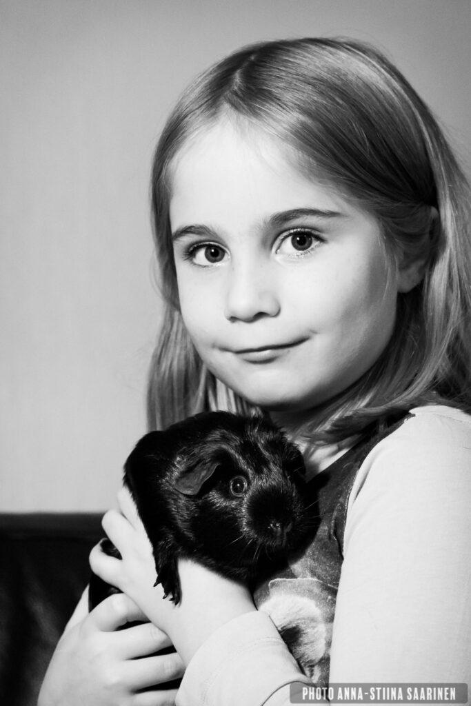 A girl with cavy and pet, Portrait, Photographer Anna-Stiina Saarinen annastiinasphotos.com